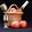 Apples, glass and bottle in the basket - Stock Photo