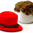 Red wig and  red bonnet — Stock Photo