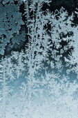 Frosty pattern on window glass — Stock Photo