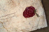 Grunge paper with sealing wax — Stock Photo