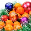 Mandarin,pine branches and balls — Stock Photo #1474728