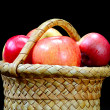 Apples in the basket on a black - Stock Photo