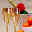Champagne flutes in ice bucket, - Stock Photo