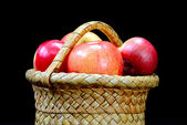 Apples in the basket on a black — Stock Photo