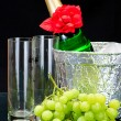 Champagne flutes in ice bucket - Stock Photo