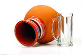 Earthenware pot and empty glass — Stock Photo