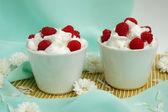 Raspberrys with white whipped cream — Stock Photo