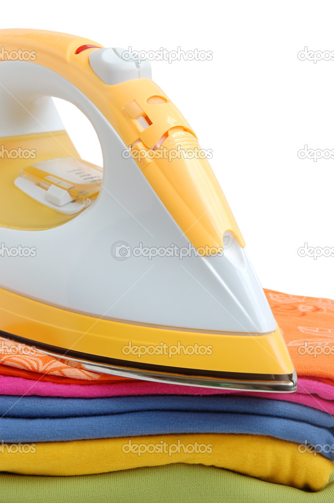 Iron and a pile of clothes on a white background — Stock Photo #1032342
