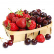 Strawberries and cherries in a basket — Stock Photo