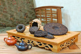 Aromatic black pu-erh tea leaves. — Stock Photo