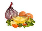 Raw eggs and different vegetables — Stock Photo