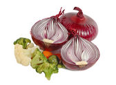 Spanish red onion and different vegetabl — Stock Photo