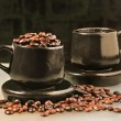 Royalty-Free Stock Photo: Two cups and coffee beans