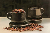 Two cups and coffee beans — Stock Photo