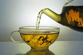 Glass teapot and tea cup — Stock Photo