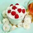 Raspberrys with white whipped cream - Stock Photo