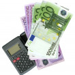 Calculator with Euro bank notes — Stock Photo