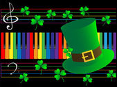 Piano keys and green hat — Stock Photo