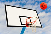 Ball and backboard on background sky — Stock Photo