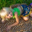 Stock Photo: Girl on rug