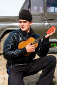 Guy with the guitar — Stock Photo
