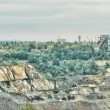 Stock Photo: Quarry and city