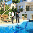 Swimming pool cleaner and owner — Stock Photo #1006275