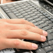 Hand on laptop — Stock Photo