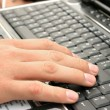 Stock Photo: Hand on laptop
