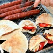 Grilled sausages,halloumi cheese with to — Stock Photo