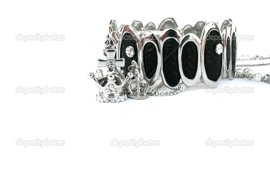 Silver bracelet and crowns isolated on the white.  Stock Photo #1024808
