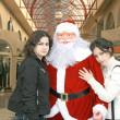 Stock Photo: SantClause and girls