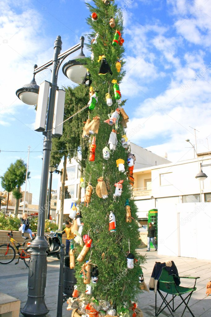 Fir tree with bottles in the street. — Foto de Stock   #1035262