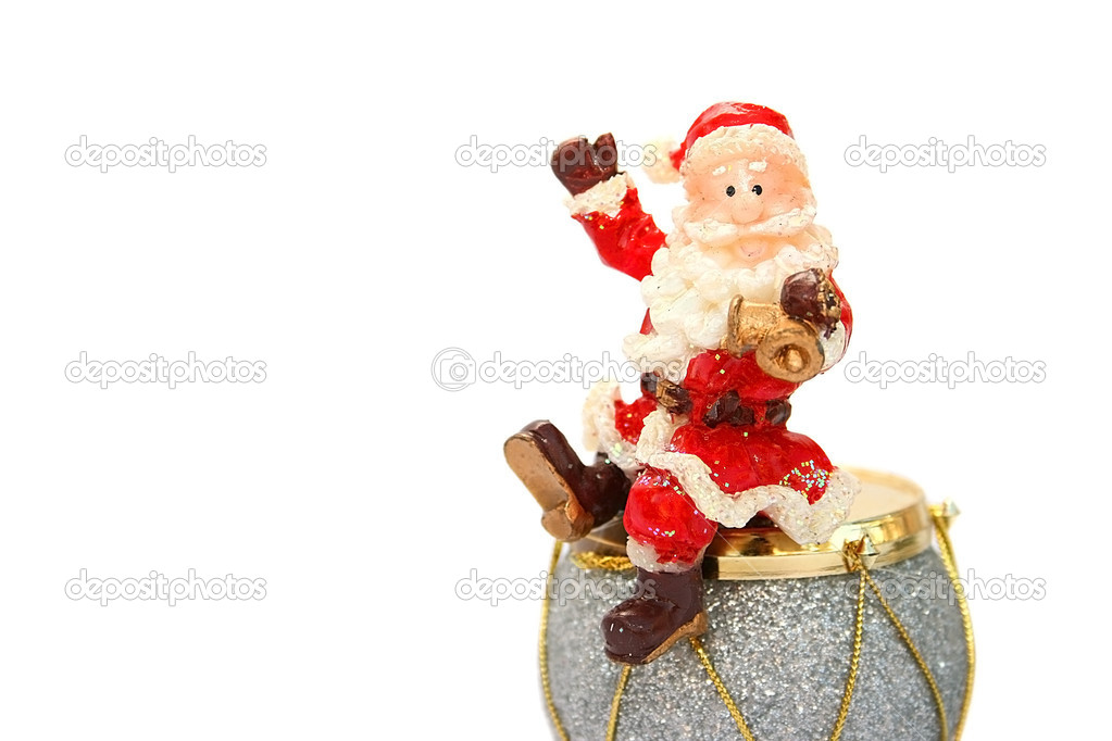 St.Clause holding bell,sitting on the drum. — Stock Photo #1036455