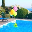Royalty-Free Stock Photo: Balloons on swimming pool