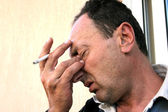 Crying man with cigarette — Stock Photo