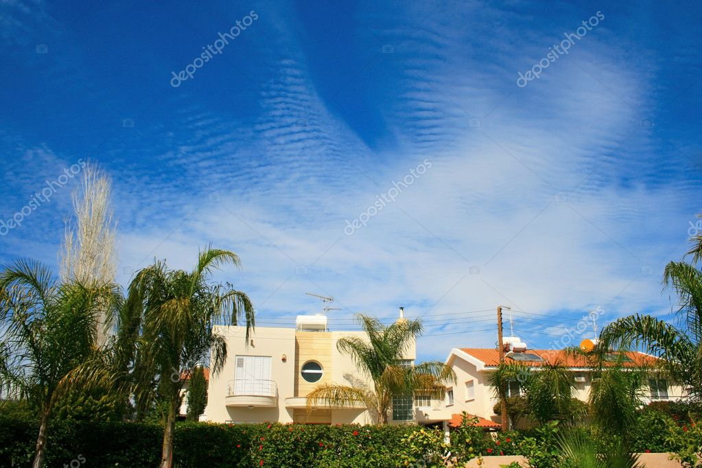 Fantastic clouds in blue sky above houses. — Stock Photo #1279146