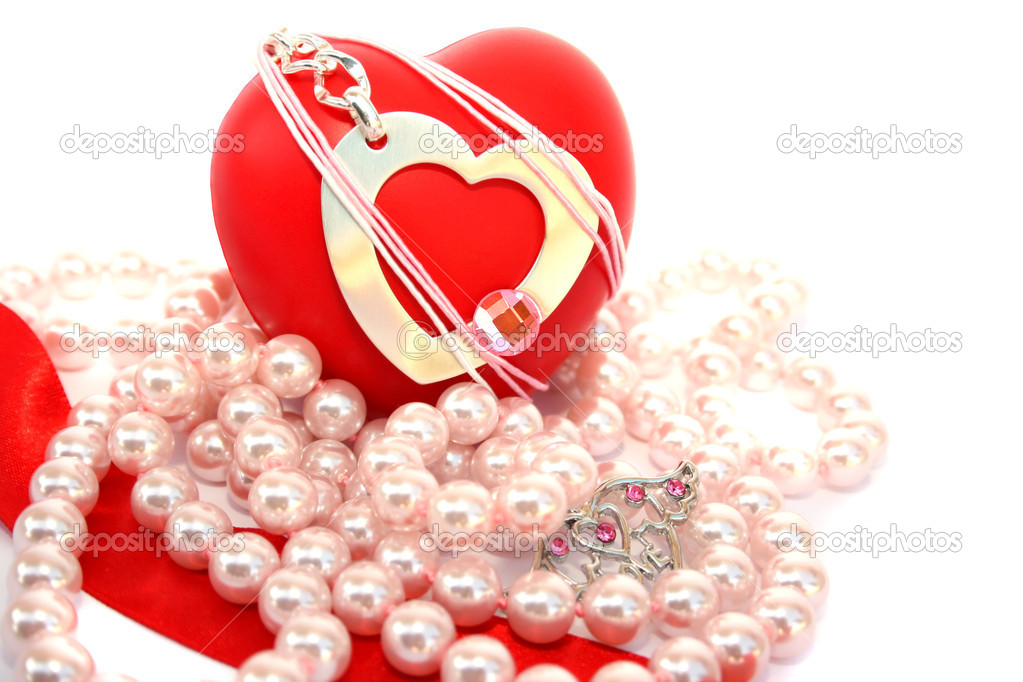 Valentine hearts,red ribbon,pink pearls on white background. — Stock Photo #1581937