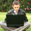 Stock Photo: Student using laptop
