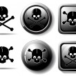 Black buttons with skull sign — Stock Vector