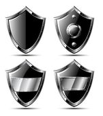 Set of four black steel shields — Stock Vector