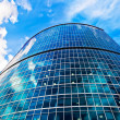 Blue skyscraper and cloudy sky — Stock Photo #1007527