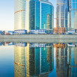 Stock Photo: Business skyscrapers and reflections in