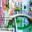 Bridge and canal in Venice - Stock Photo