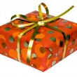 Gift box with golden ribbon — Stock Photo