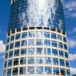 High skyscraper with clouds reflections — Stock Photo