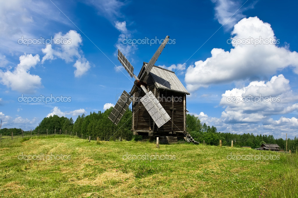 Old windmill under blue sky — Stock Photo #1006060