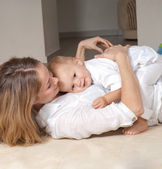 Young mother and her little son — Stock Photo