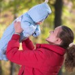 Stock Photo: Mother with her son in autumn forest