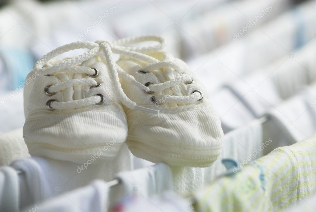 Baby's bootees is drying on draining board — Stock Photo #1082173